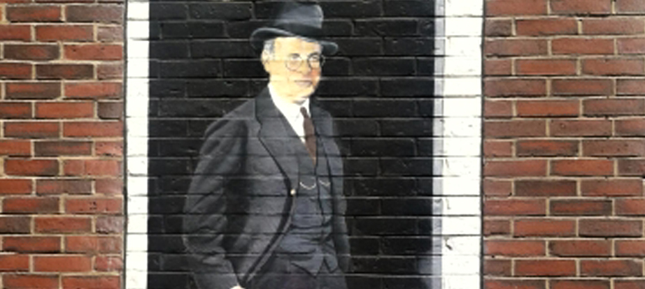 Man in suit and hat